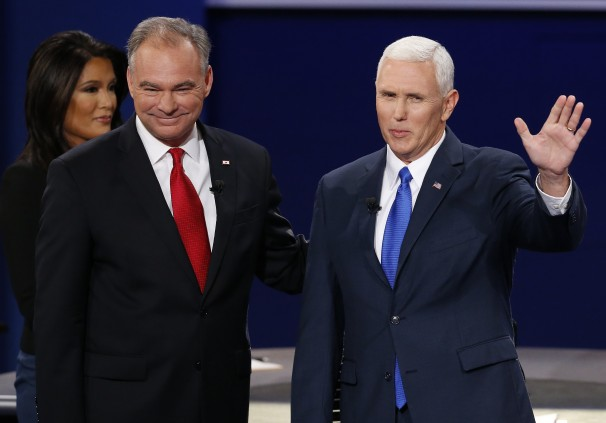 Going from left to right: Moderator Elaine Quijano of CBS News lets Democrat Senator Tim Kaine & Republican Governor Mike Pence wave to the crowd after an interesting vice presidential debate.