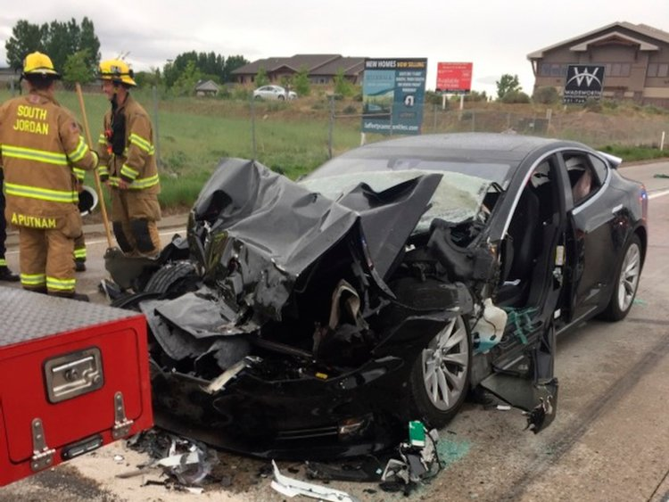 Photo Credits:  http://www.businessinsider.com/tesla-model-s-driver-says-autopilot-engaged-in-utah-crash-2018-5