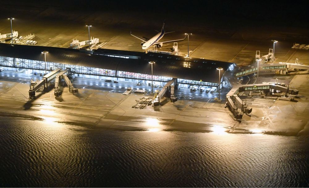 An aerial view shows a flooded runway at Kansai airport, which is built on a man-made island in a bay, after Typhoon Jebi hit the area, in Izumisano, western Japan,in this photo taken by Kyodo September 4, 2018. Mandatory credit Kyodo/via REUTERS    ATTENTION EDITORS - THIS IMAGE WAS PROVIDED BY A THIRD PARTY. MANDATORY CREDIT. JAPAN OUT. NO COMMERCIAL OR EDITORIAL SALES IN JAPAN.