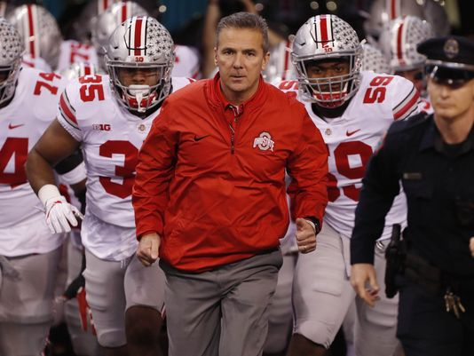 Urban Meyer (Middle) and fellow Ohio State Players (Left and Right)