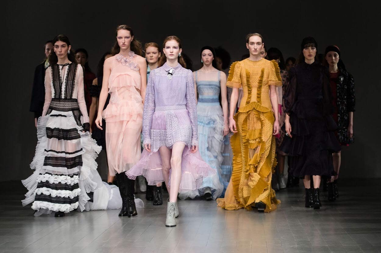 This image was posted on Gatewaynow.com, spreading the excitement about the London Fashion Week. This image shows the power in these men and women in the picture, while modeling outstanding pieces from many designers.
