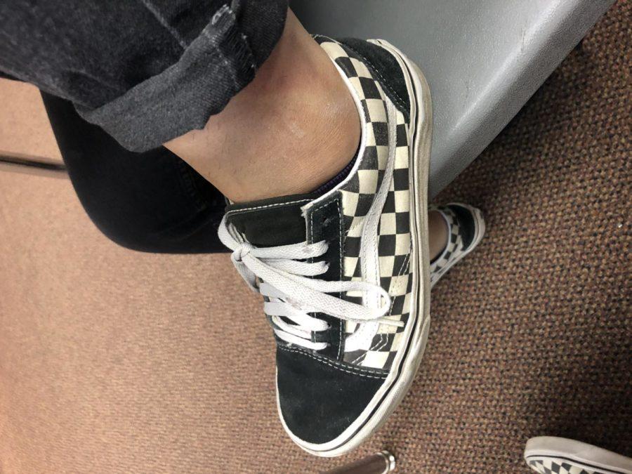 Samantha Medina,12, wearing checkered vans