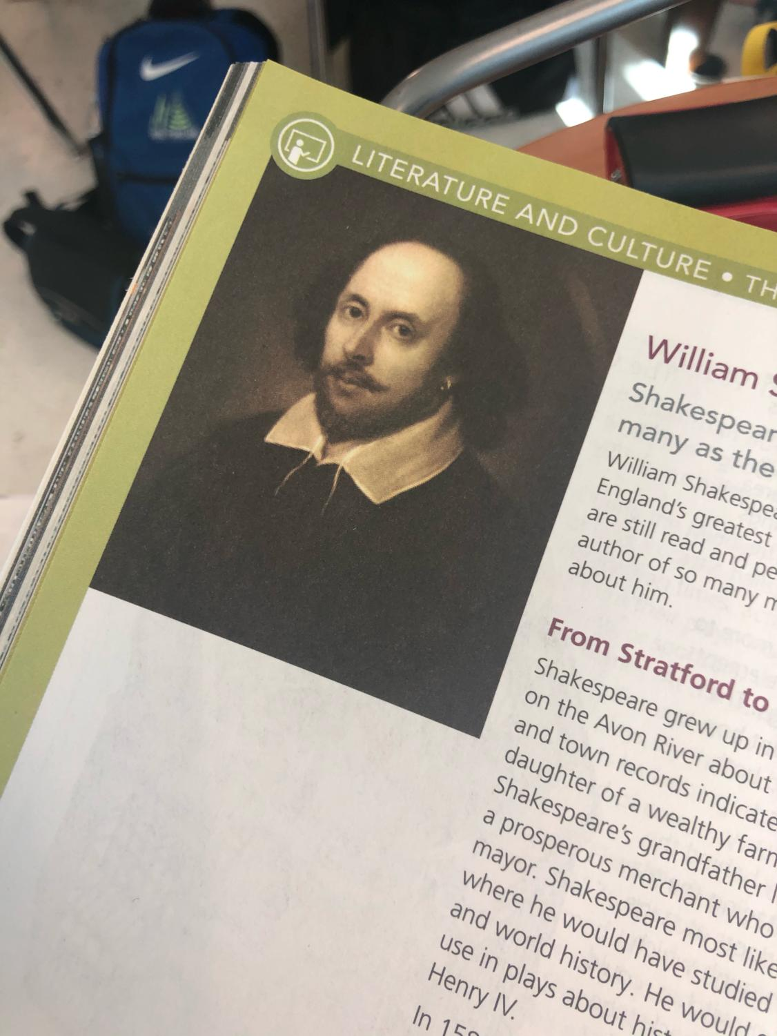 Freshman english text book used in ERHS classes. The page features a Shakespeare portrait.