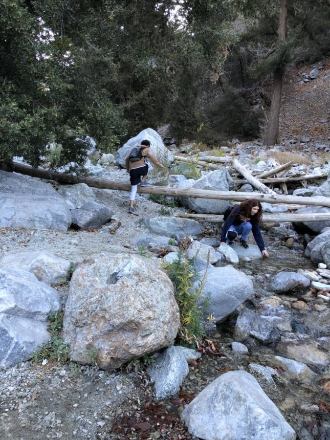 Olivia Nisson and friend by water on Mount Baldy