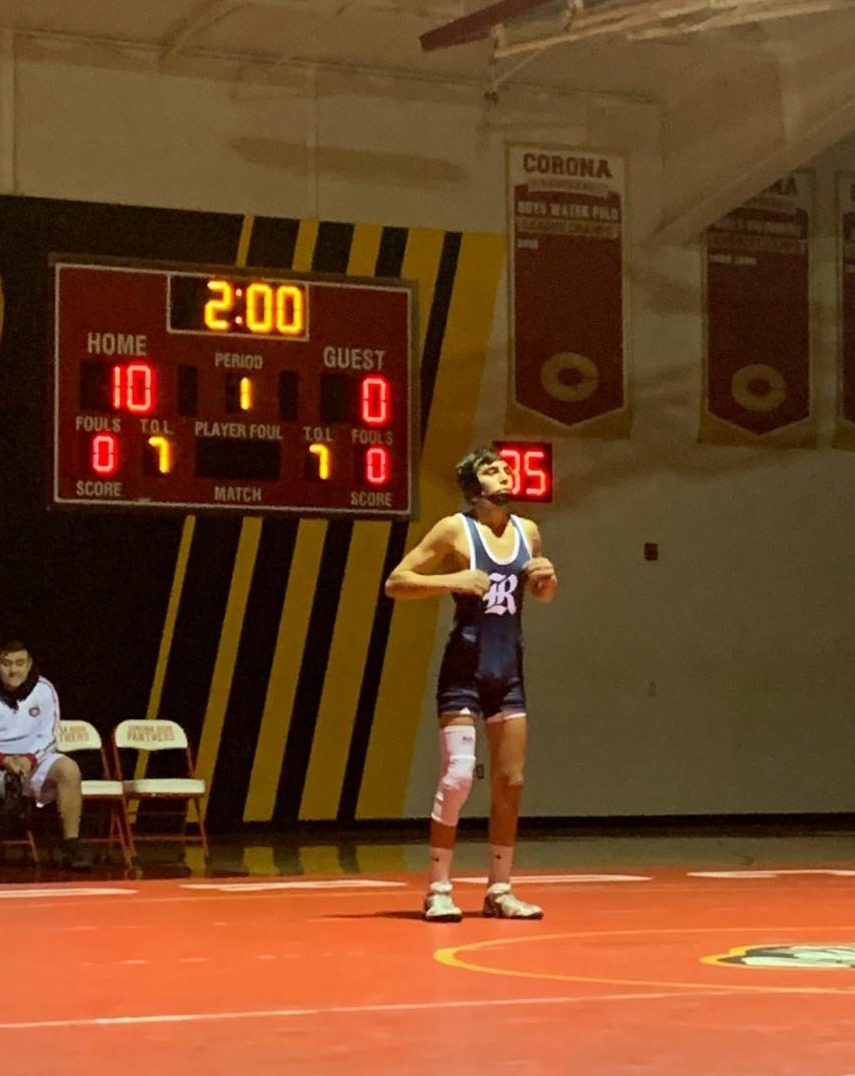 David Saenz, a sophomore varsity wrestler, in the first dual of the season against Corona