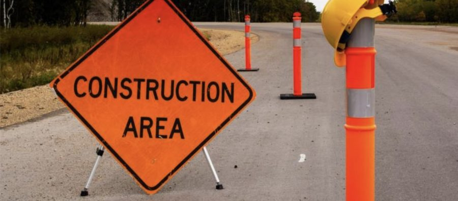 Construction zone sign and cones