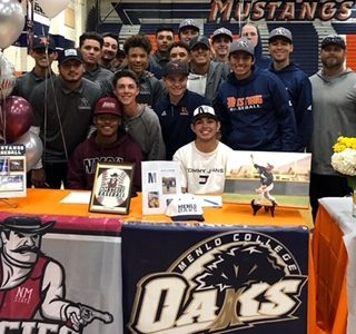 Baseball team at signing day.