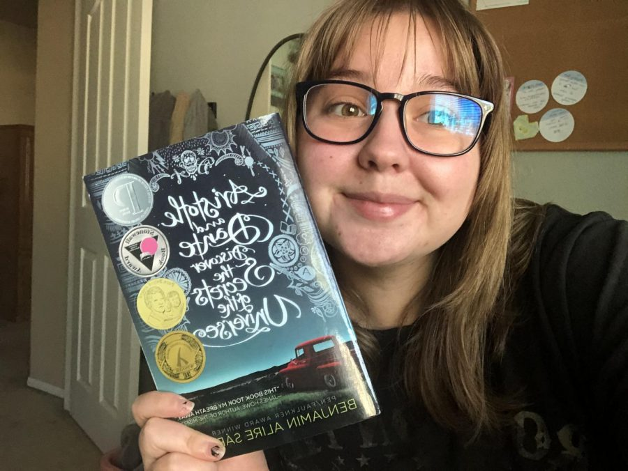 Me holding a book I love because I discuss how my mind structures what I read in the article.