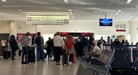Passengers waiting to board a flight at Ontario Airport.